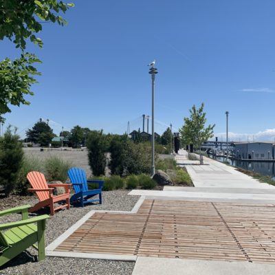 A boardwalk and sitting area overlooks the marina harbor at Clover Island.