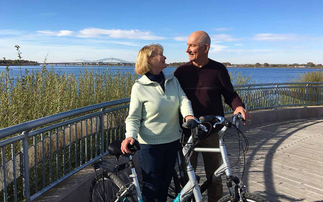 Couple with bicycles on Clover Island.