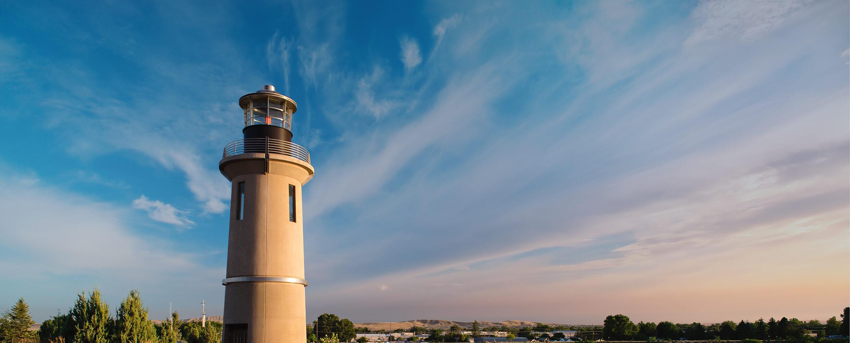 Clover Island Lighthouse with bright blue sky overhead.