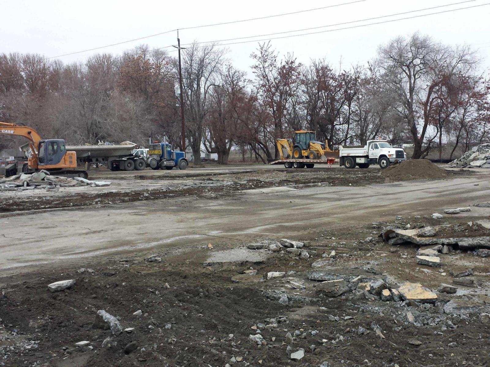 Construction crews remove debris in preparation for construction of Columbia Gardens.