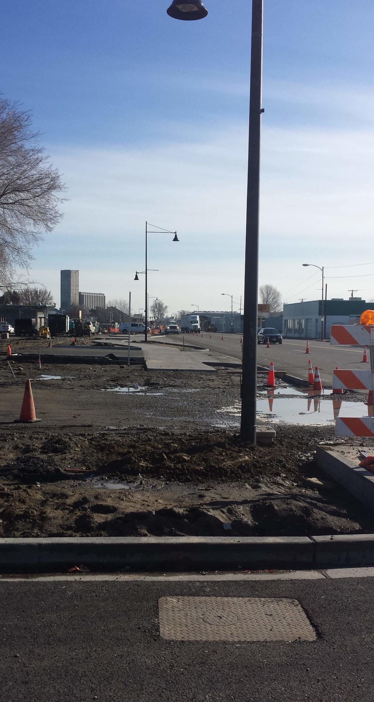 Constructing sidewalks and installing light poles.