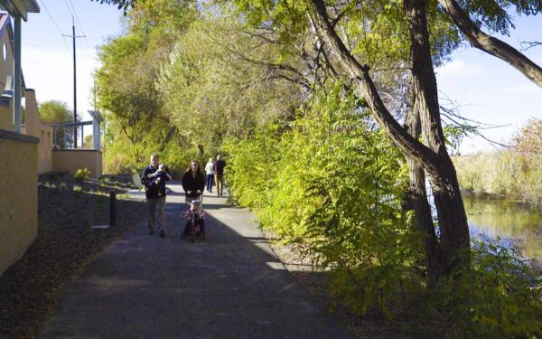 Families strolling along a pathway at Columbia Gardens.