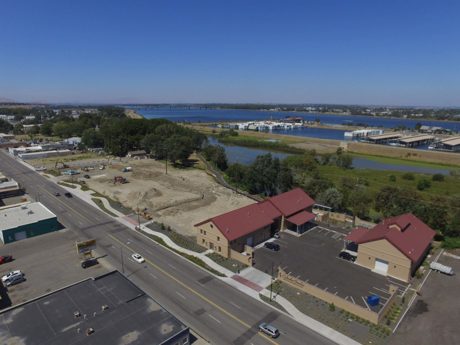 East-facing aerial of wine buildings and Phase 2 construction.