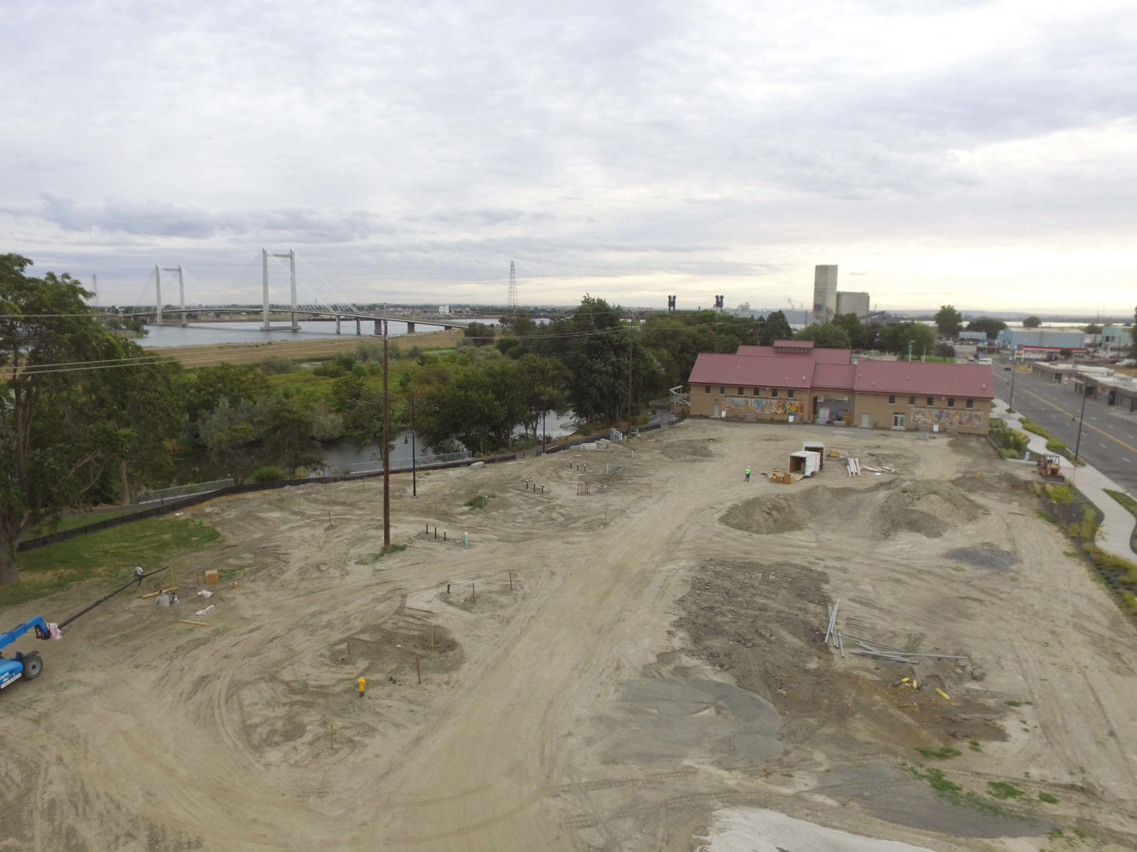 West-facing aerial showing Phase 2 dirt and equipment.