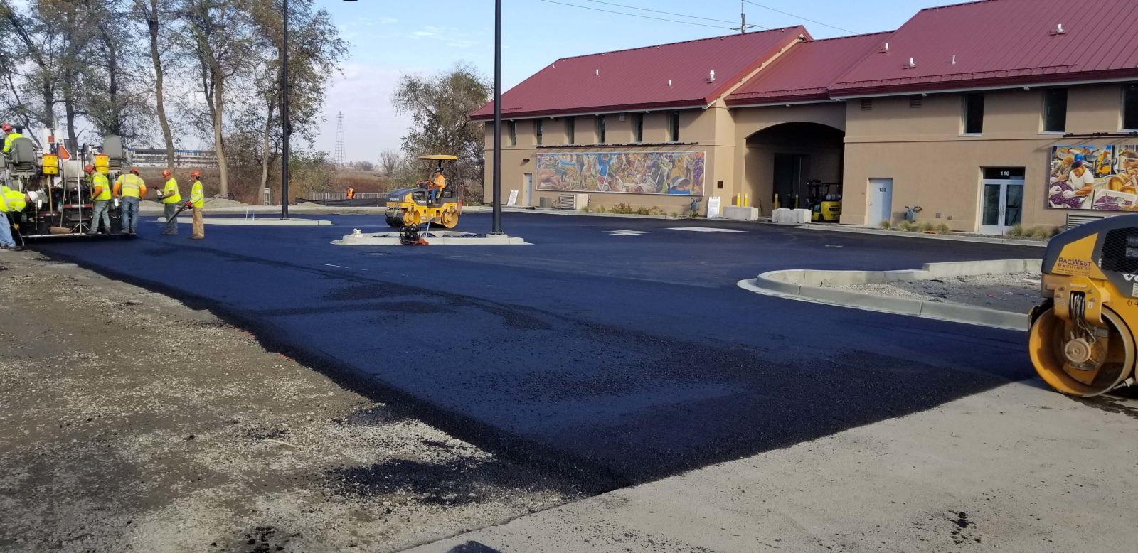 Contractors paving Date Street parking lot at Wine Village.