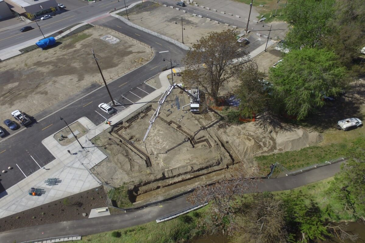 Aerial view of fourth Wine Village building foundation construction.