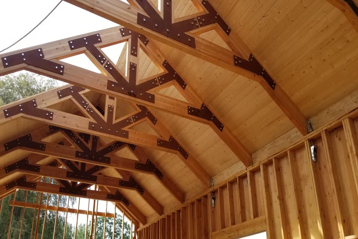 Looking up at ceiling beams of new tasting room building
