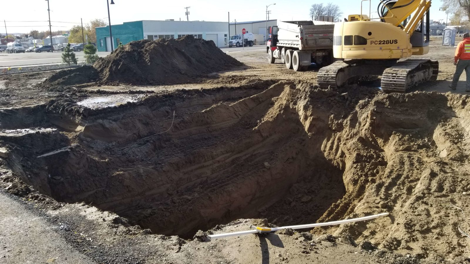 Contractors dig hole for wastewater treatment system.