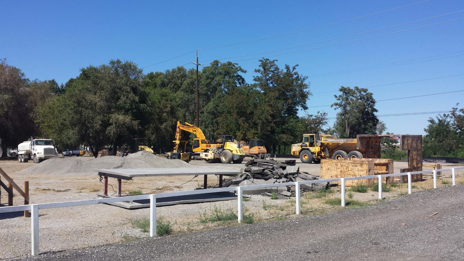 Heavy equipment and construction materials on site.