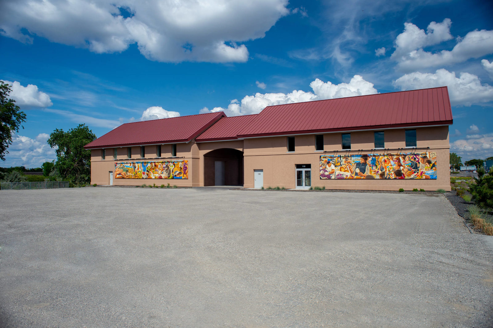 Latino Heritage Murals installed on winery buildings.