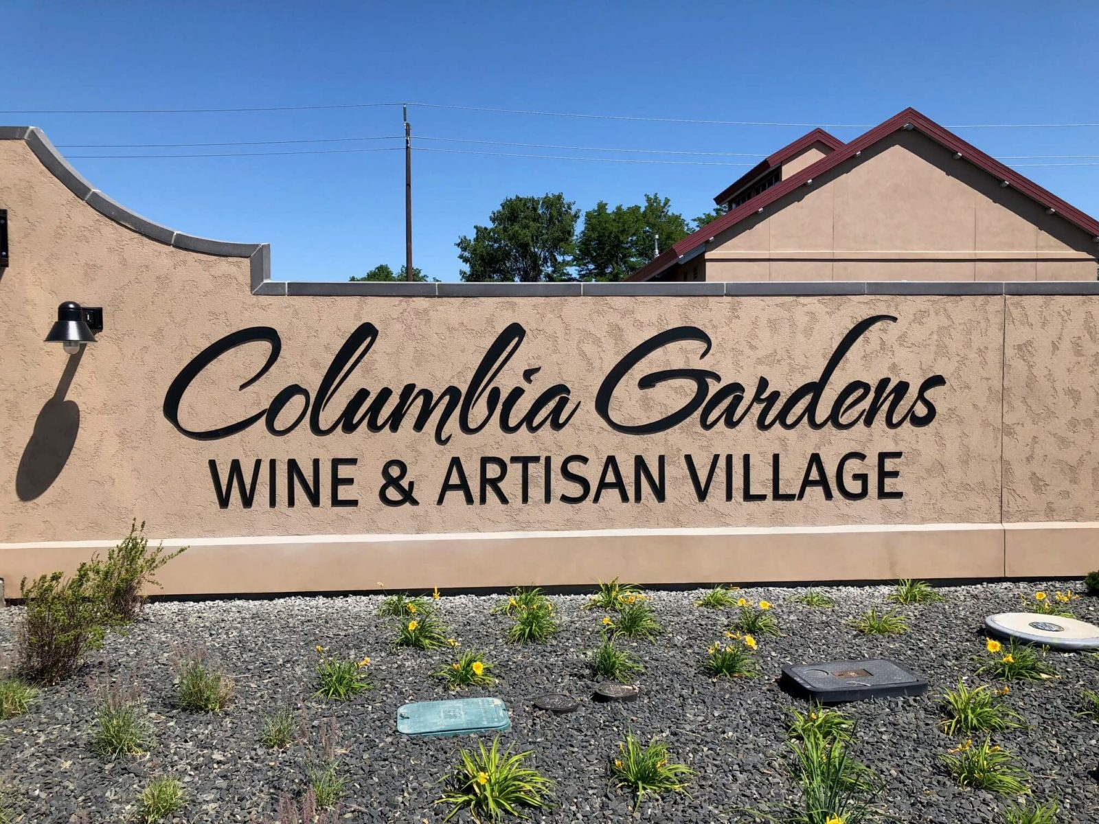 Columbia Gardens Wine & Artisan Village signage.