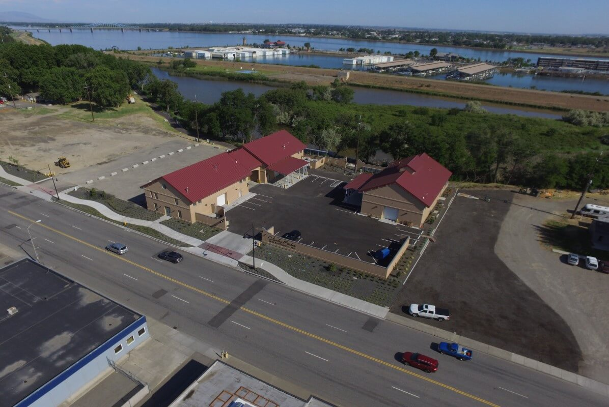 First buildings and parking, with Clover Island in background.
