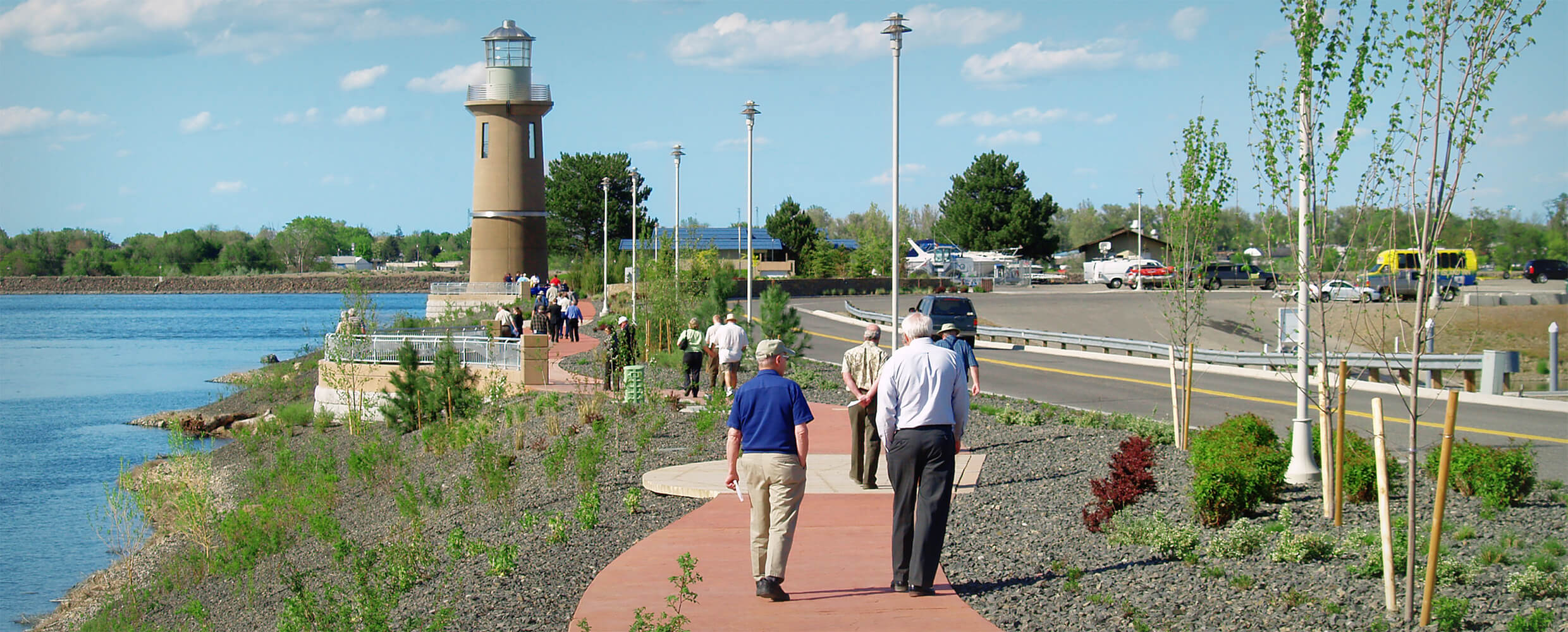 Community members strolling on a Clover Island pathway.