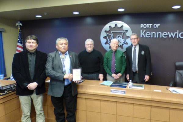 Port staff presents plaque to Confederated Tribes representative.