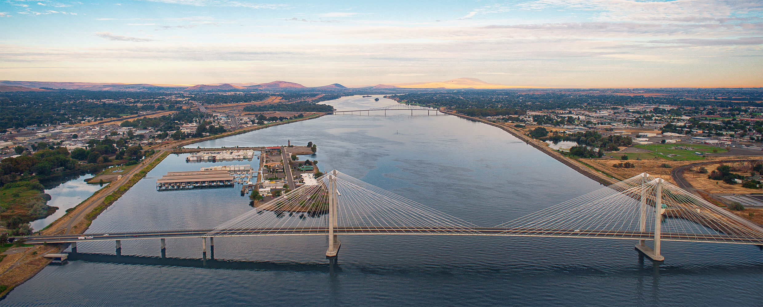 Aerial of Ed Hendler Bridge with Clover Island in background.