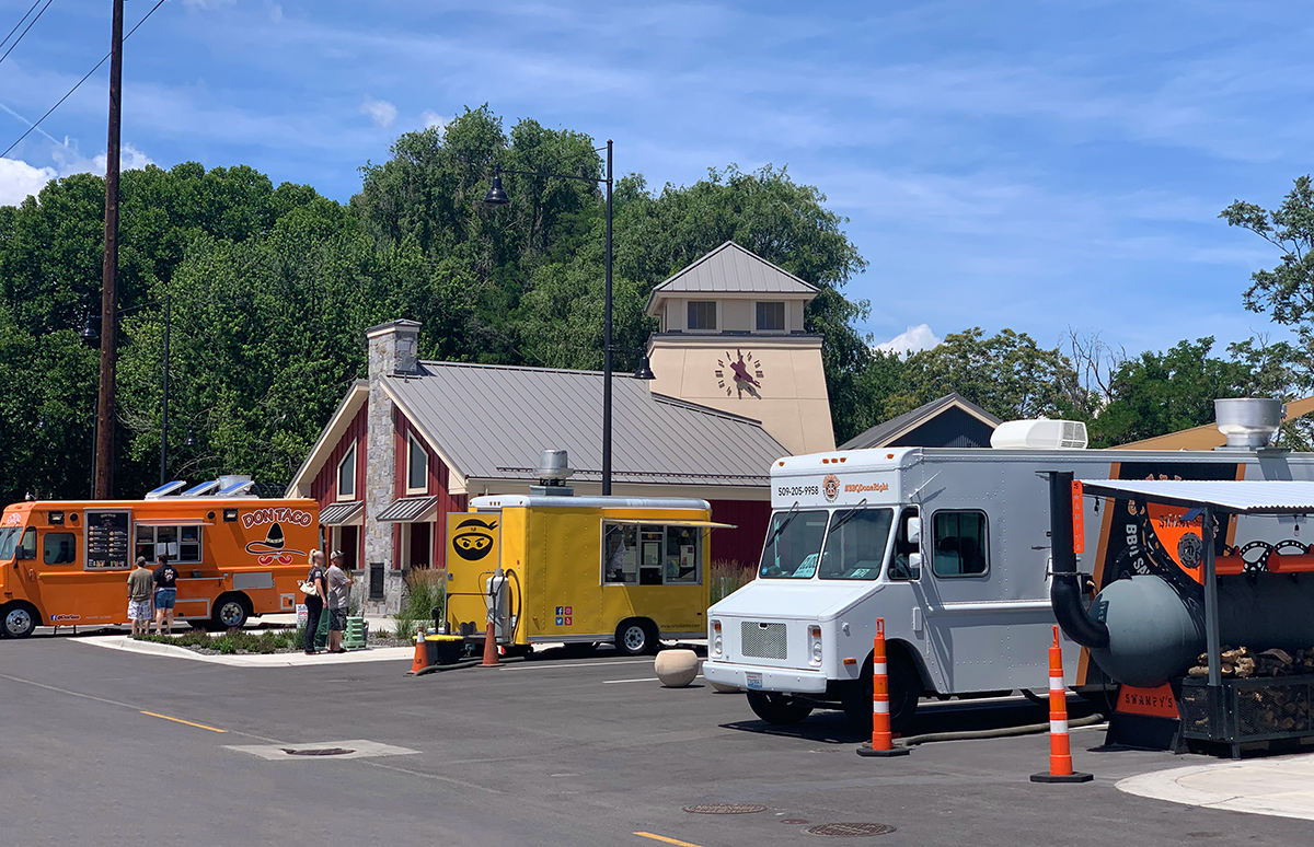 Food trucks serving customers at Columbia Gardens.