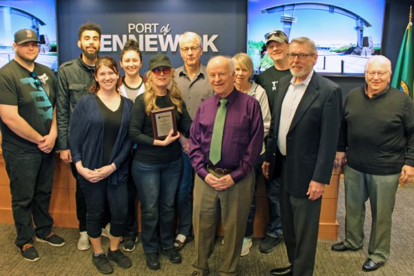 "Commissioners present ET Estate Sales representatives the ""2019 Friend of the Port"" plaque."