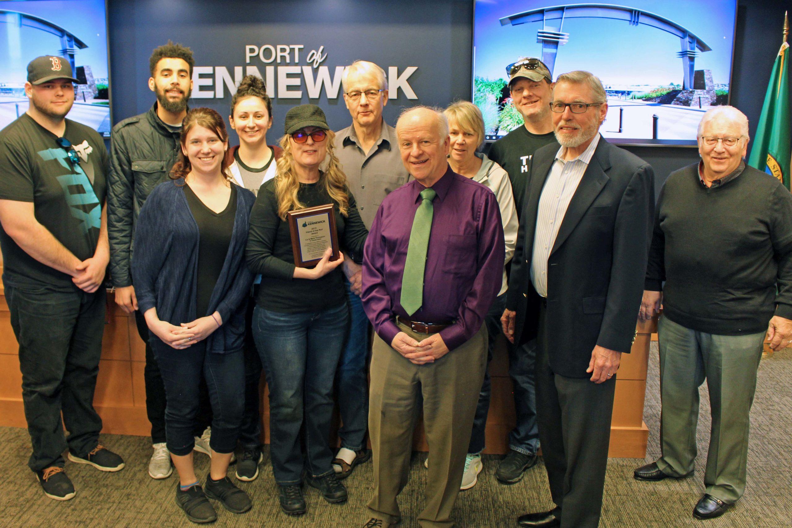 "Commissioners present ET Estate Sales representatives the ""2019 Friend of the Port"" plaque."