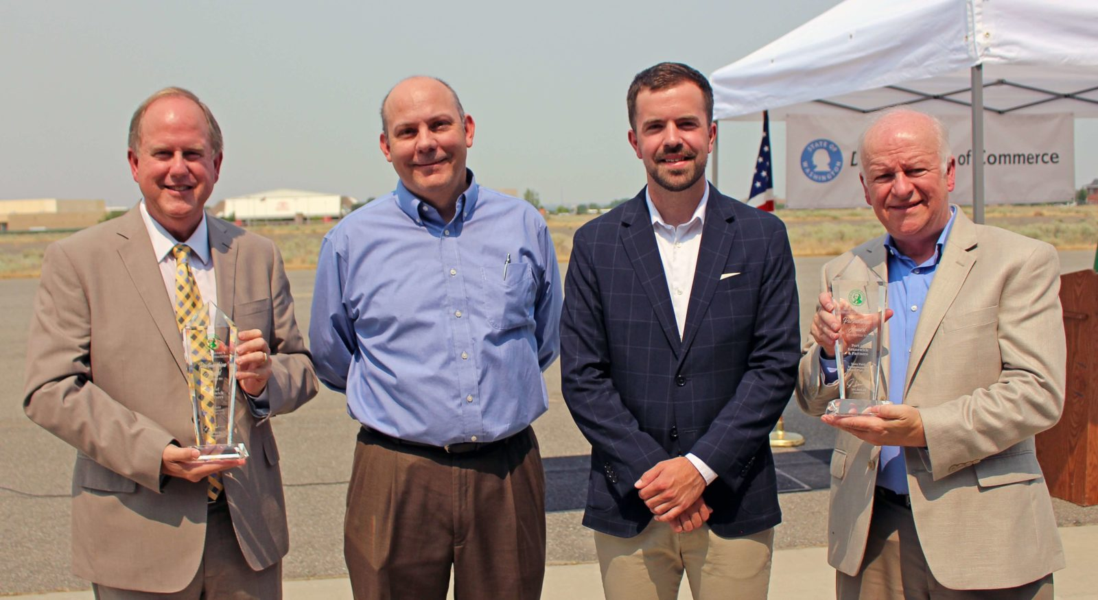 Governor's staff presents Smart Partnership Award for Vista Field planning to Port and City of Kennewick.