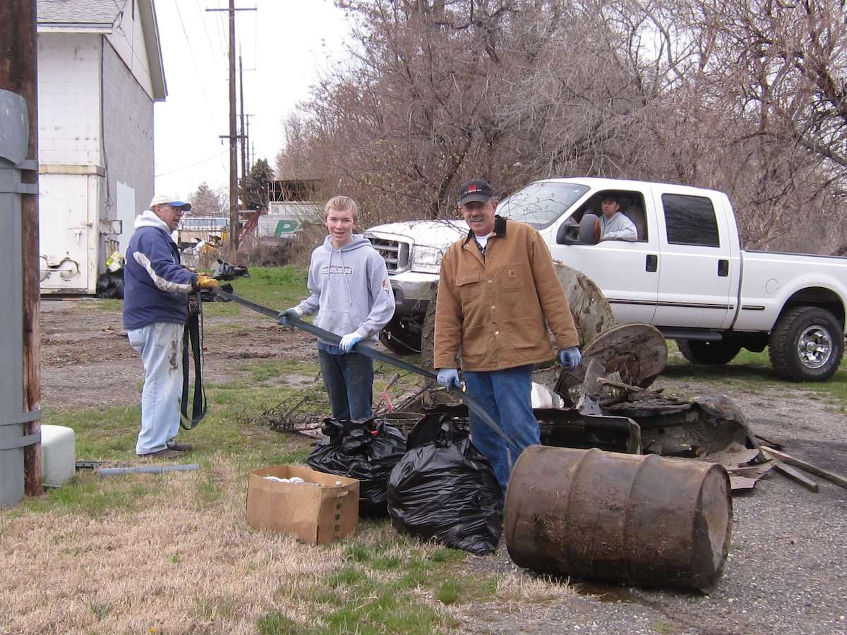 Community members help clean up debris to prepare for redevelopment.