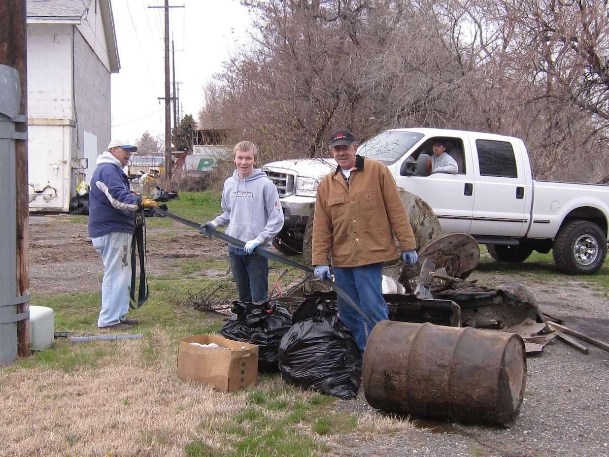 Community members help clean up debris to prepare for redevelopment.