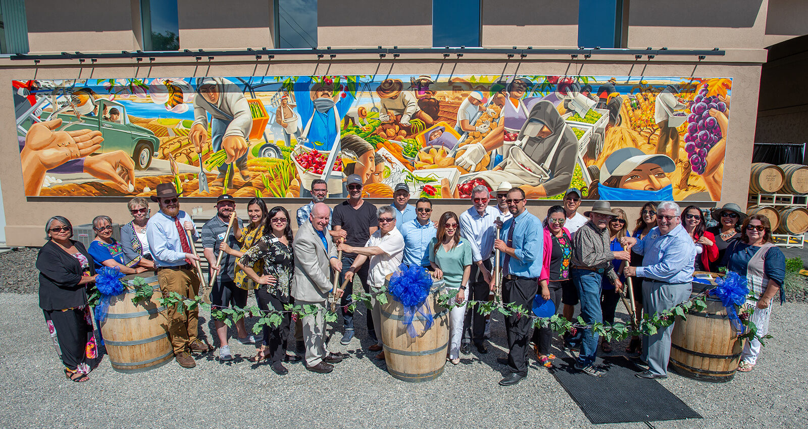 Officials prepare to lop a ceremonial vine to celebrate the Latino Heritage Mural.