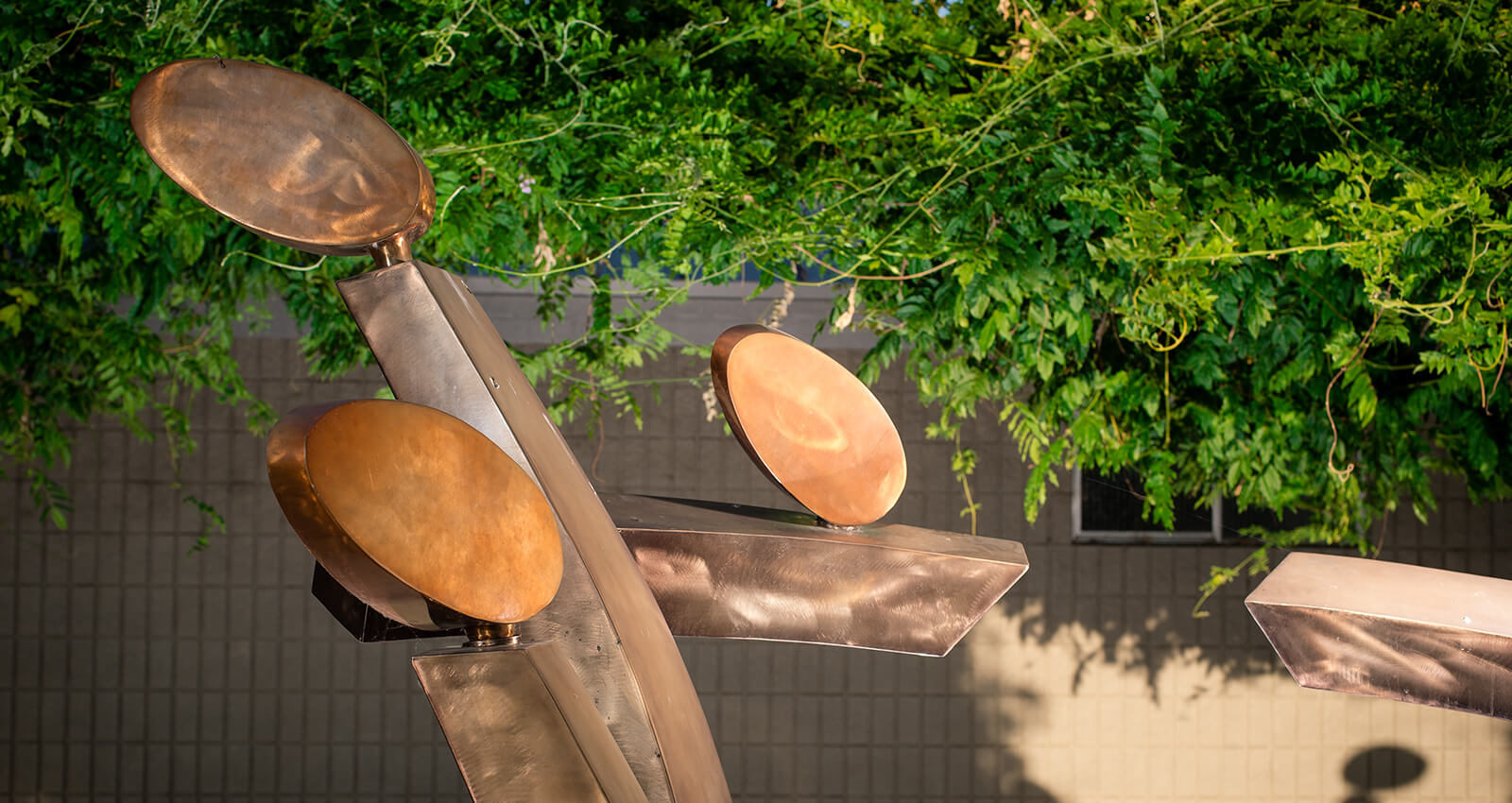 A section of the Family Group artwork's brushed steel and copper structure.