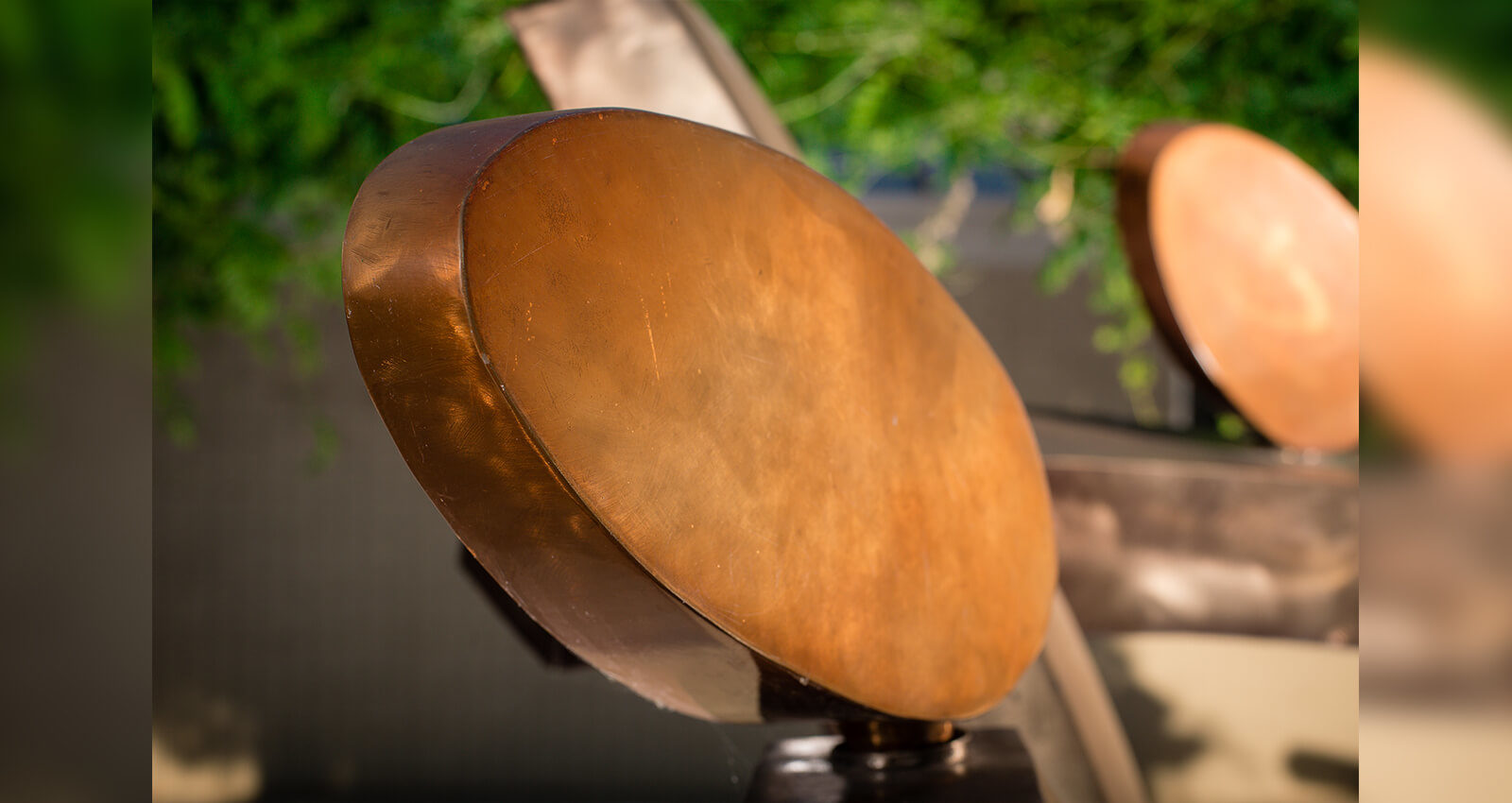 Close up of the Family Group artwork's brushed steel and copper structure.
