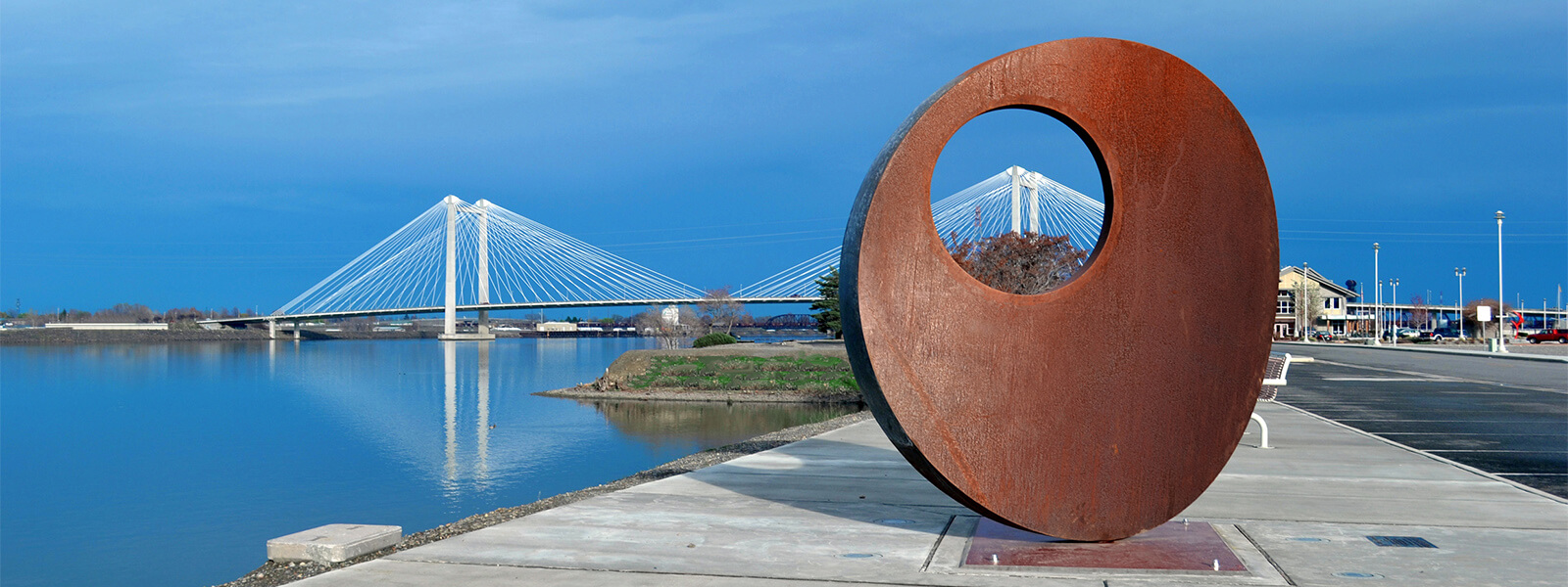 Mother of Reinvention II artwork with Ed Hendler Bridge in the distance.