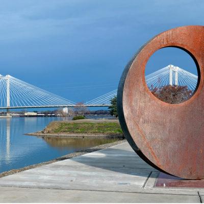 Mother of Reinvention II artwork with Ed Hendler Bridge in background.