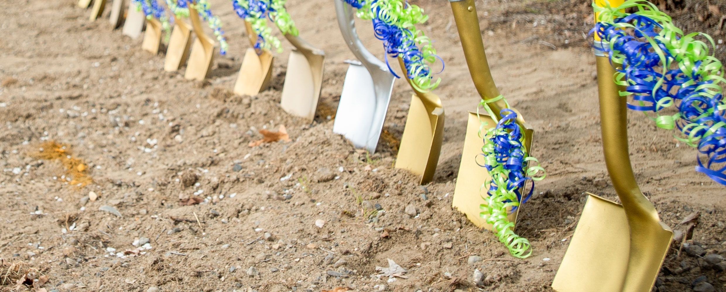 Ceremonial shovels in the dirt at Vista Field groundbreaking event.