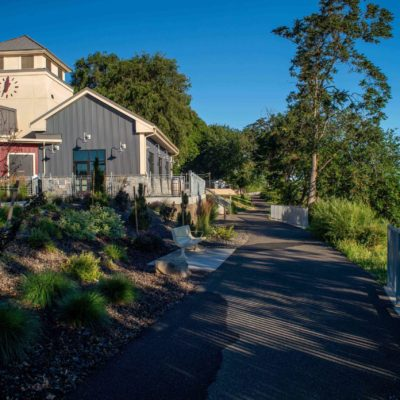 The paved pathway at Columbia Gardens runs alongside the interior Columbia River waterfront.