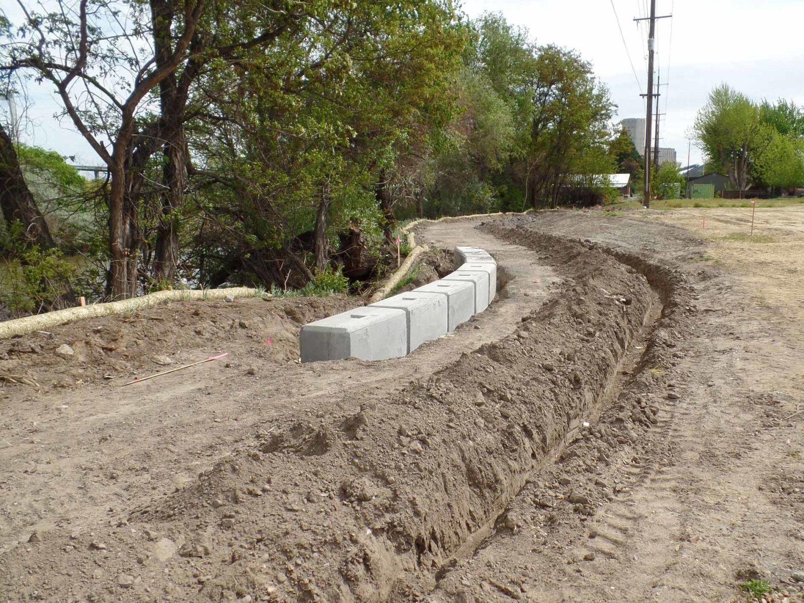 Dirt work begins for pond trail construction.