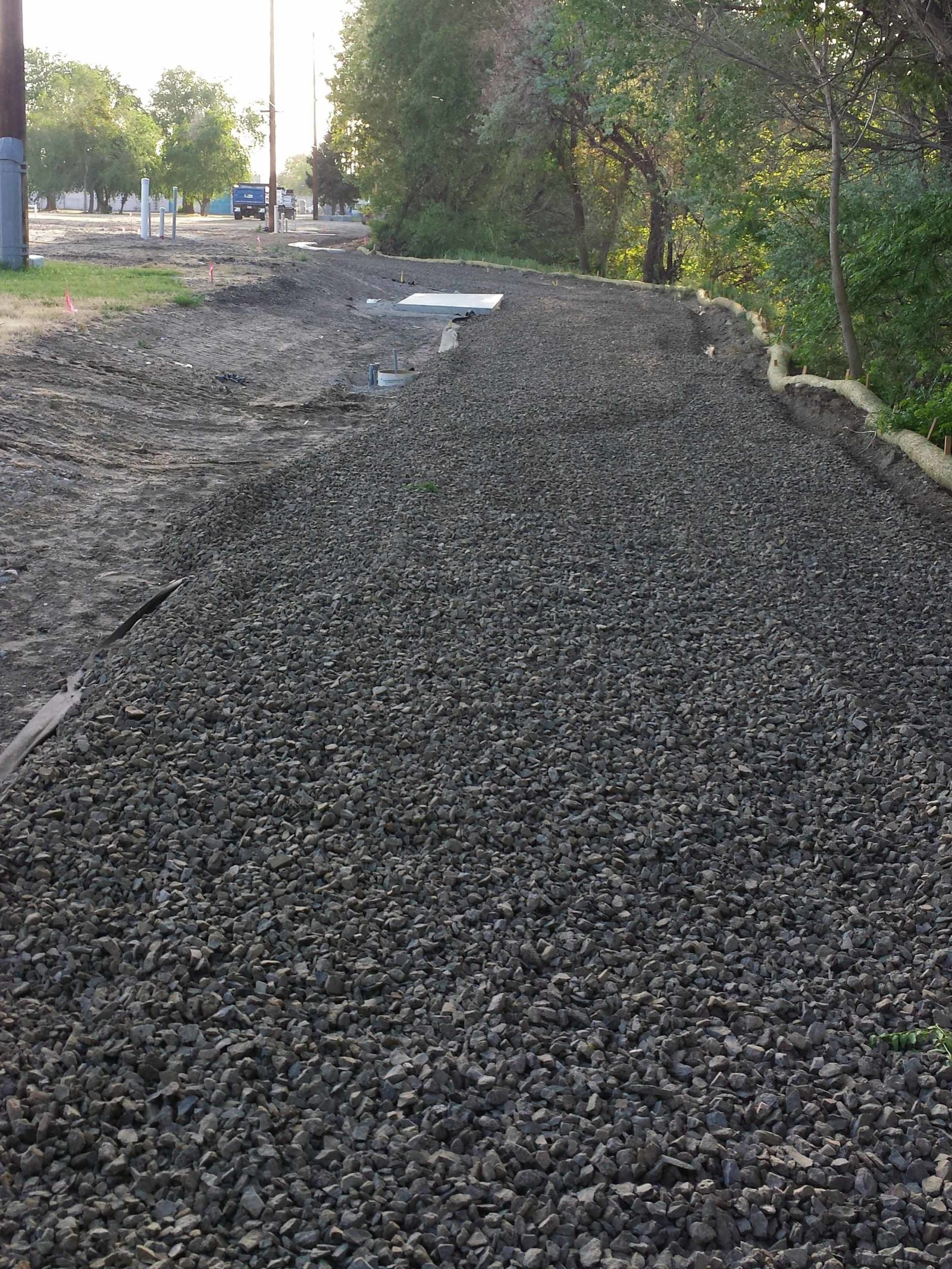 Pond trail construction advances with placement of gravel.