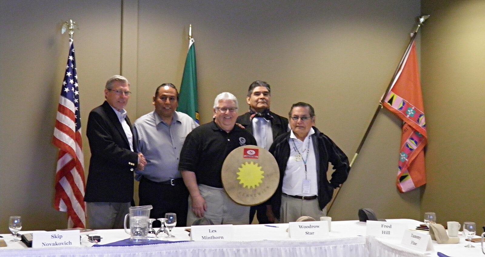 Confederated Tribal representatives present ceremonial drum to Port Commissioners.