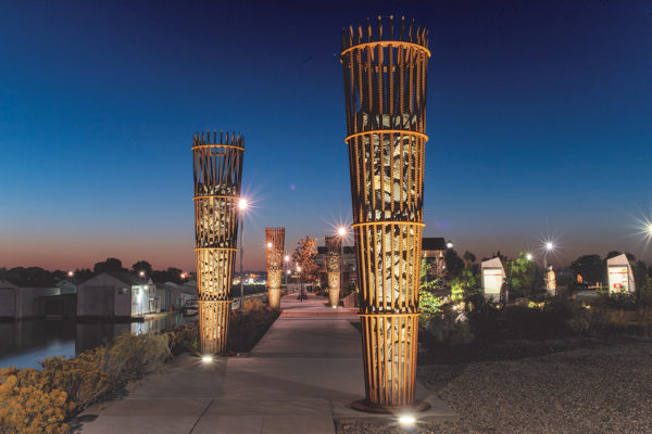 "Spotlights illuminate the Sapáxikas ""Willow Fish Traps"" artwork structures."