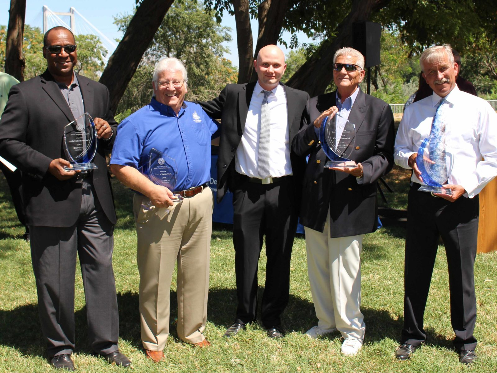 City, County, Port, and College reps receive revitalization award.