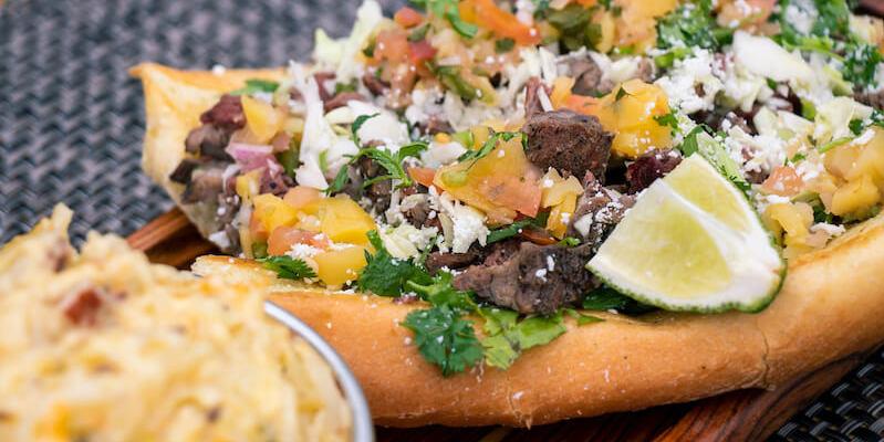 Swampy's BBQ smoked skirt steak taco hoagie with smoked potato casserole.