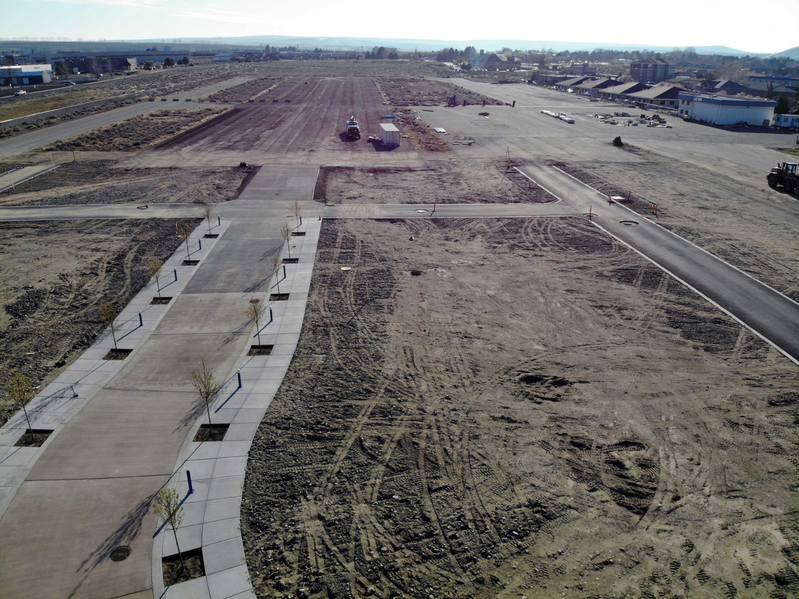 Aerial view of tree lined street and Vista Field Phase One construction.