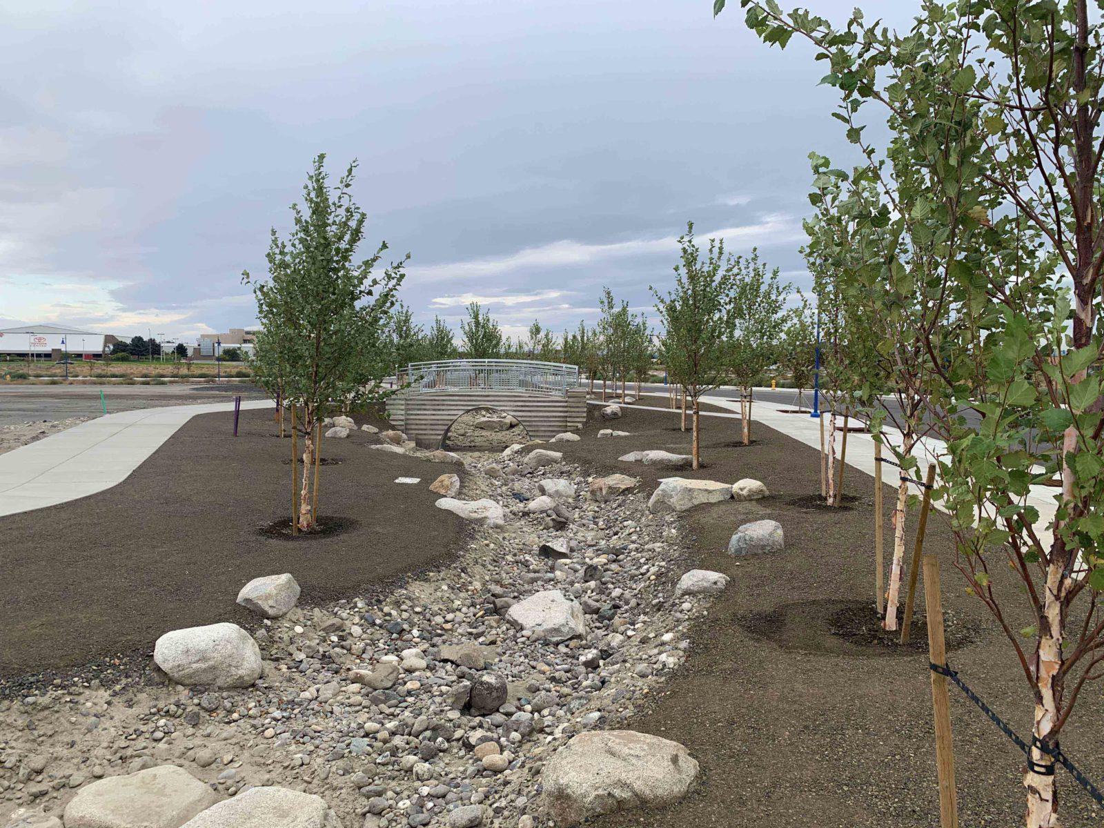 A water feature at Vista Field runs under a foot traffic bridge - phase one redevelopment.