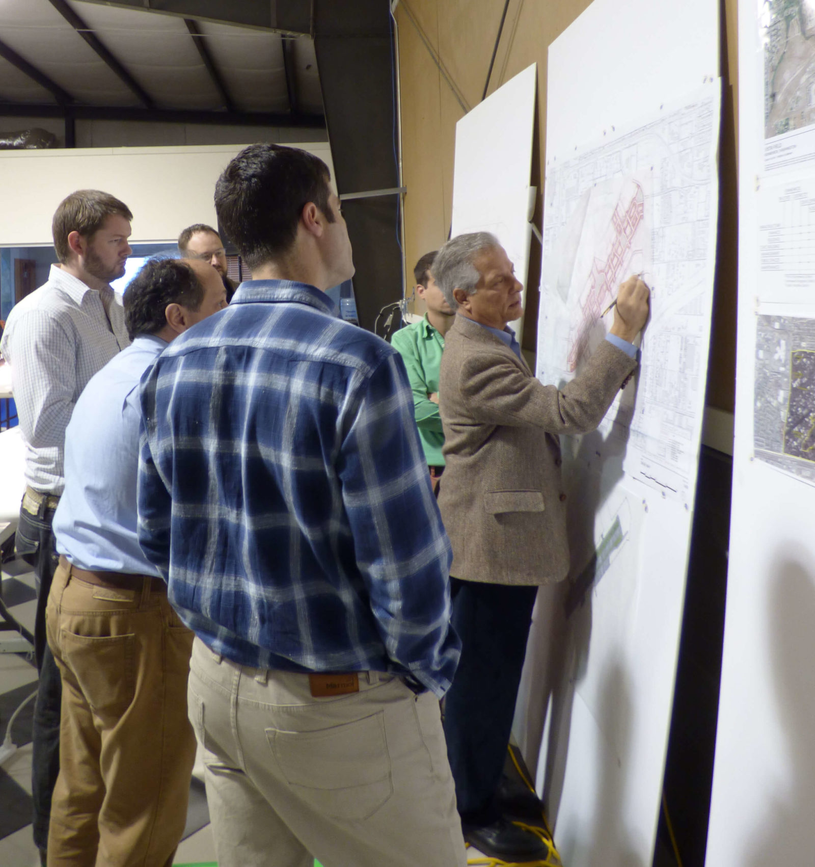 Andres Duany makes planning edits before onlookers at Vista Field Charrette.