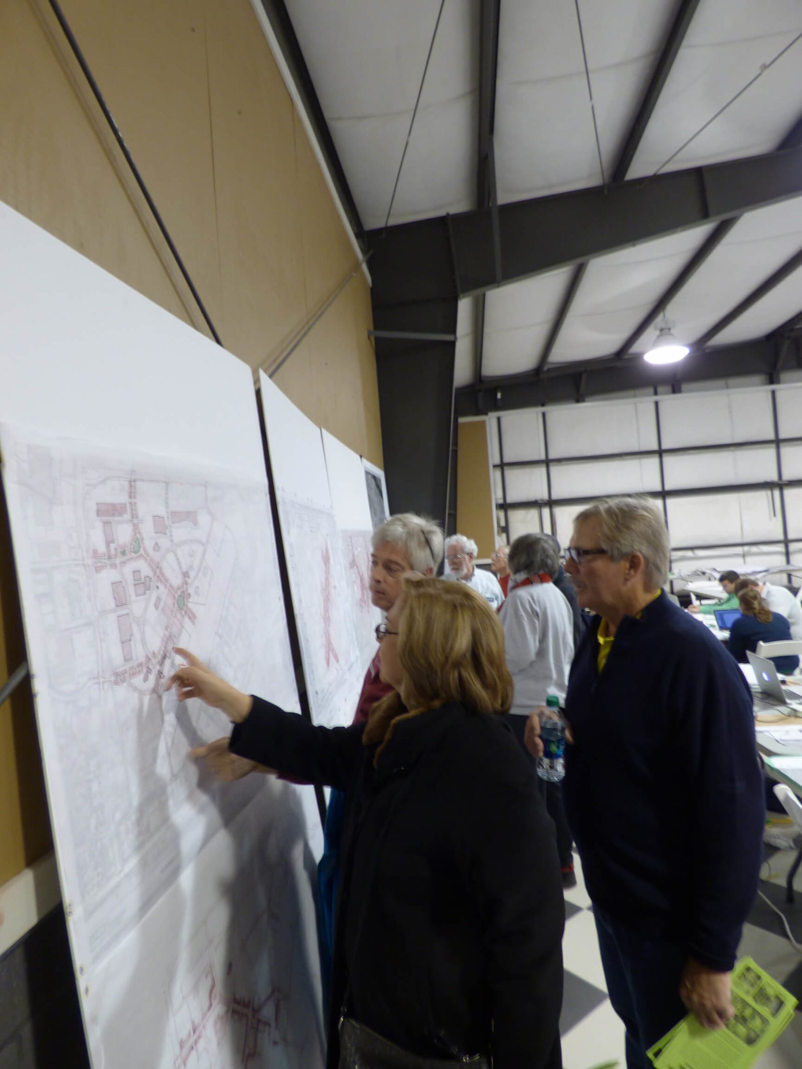 Audience members view and comment on plans during Vista Field Charrette.