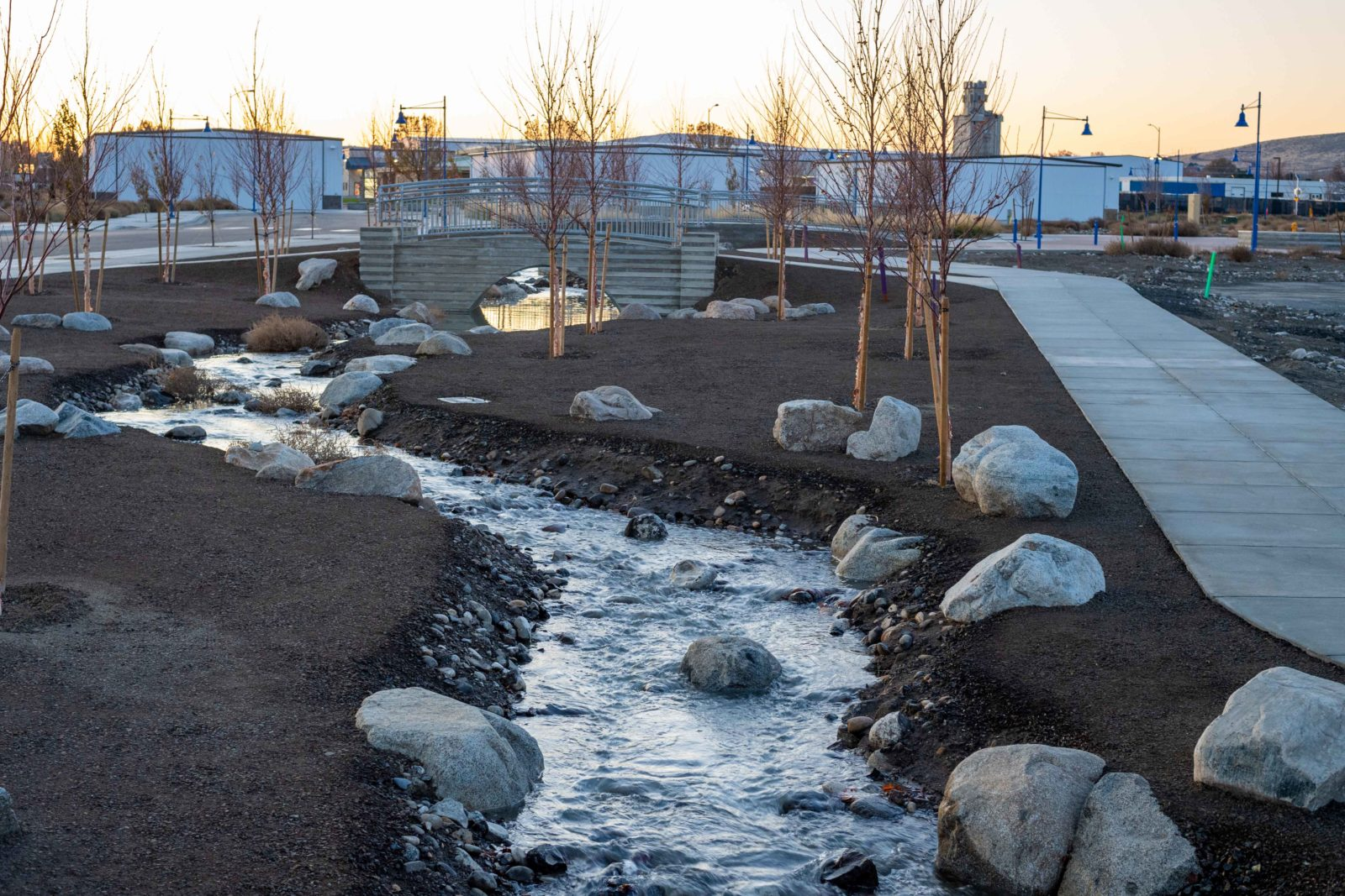 A waterway feature runs alongside the sidewalk in parts of Vista Field.