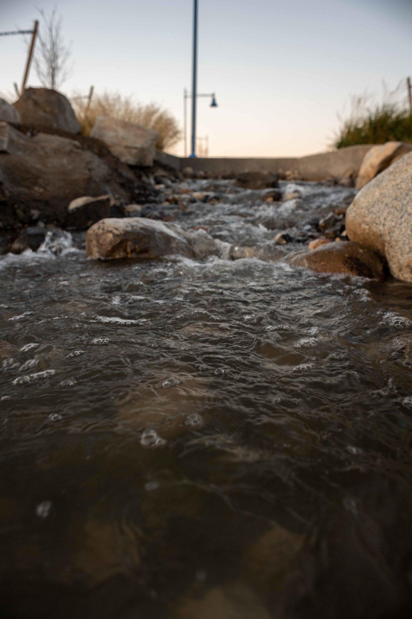 Water spilling over rocks in a Vista Field waterway.