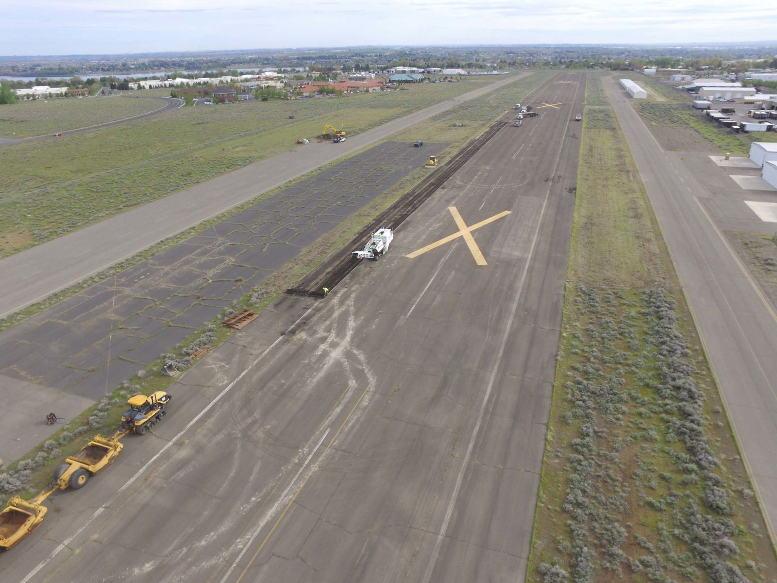 Aerial view of heavy equipment grinding asphalt.