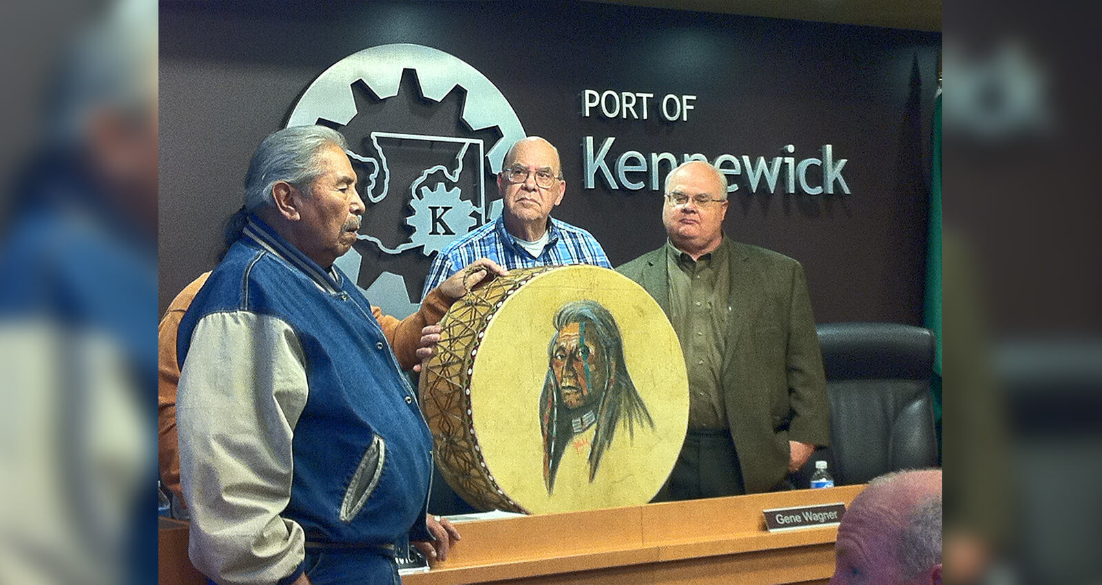 Chief Carl Sampson presents painted drum to Port Commissioners.