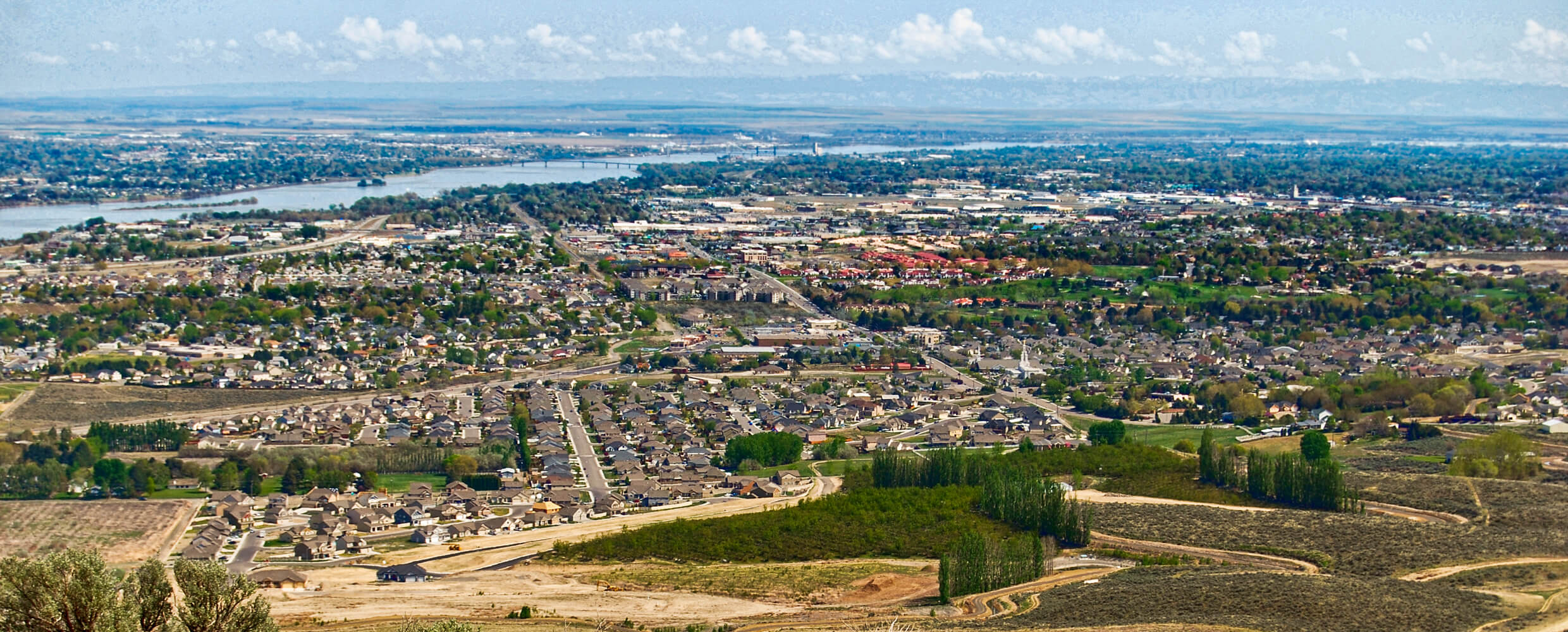 Aerial of the Tri-Cities area with river in distance.