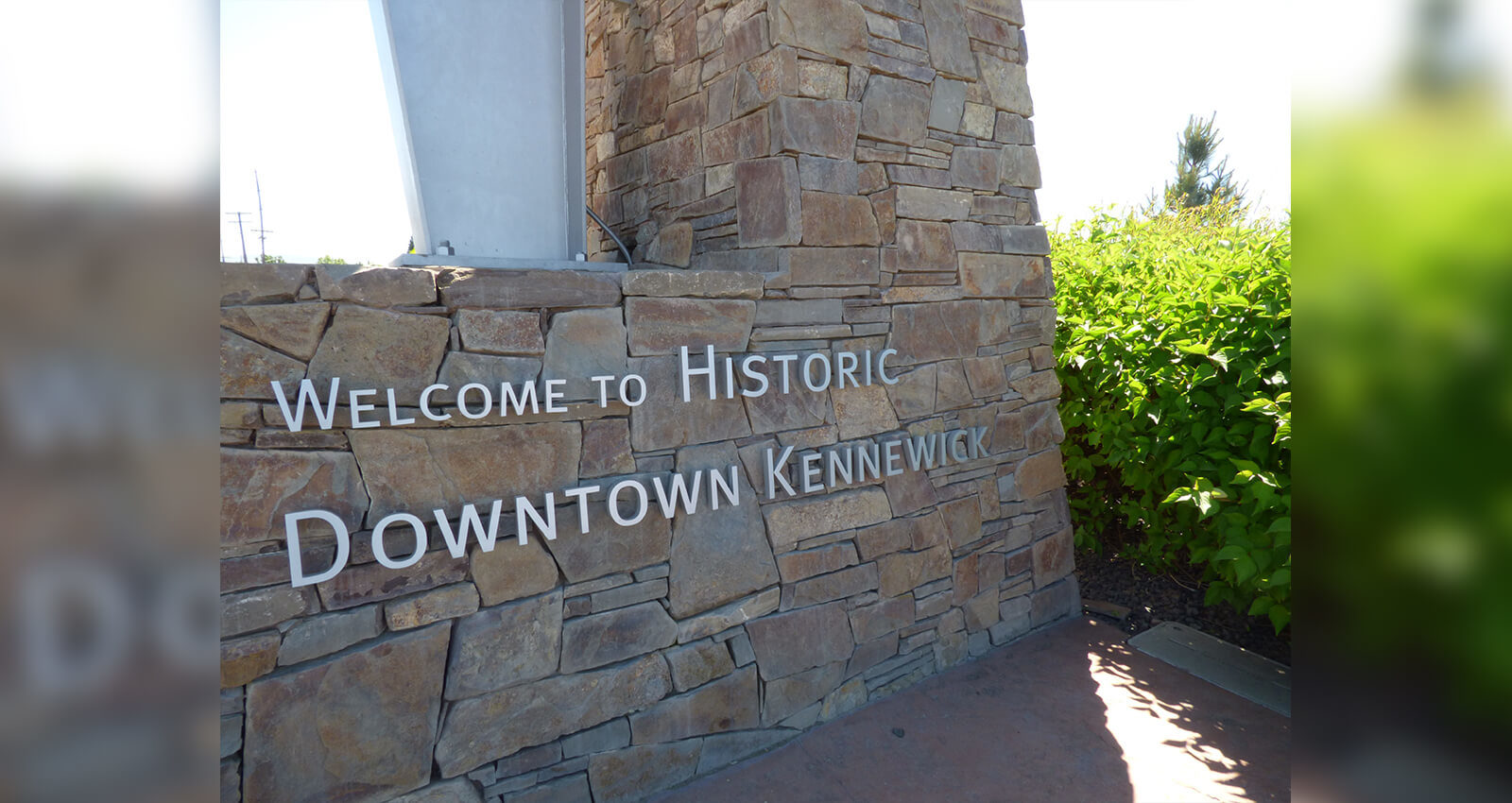 Welcome to Historic Downtown Kennewick sign on island's gateway arch.