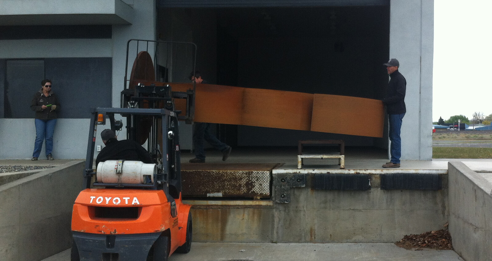 Aspirations artwork section being loaded on a forklift.
