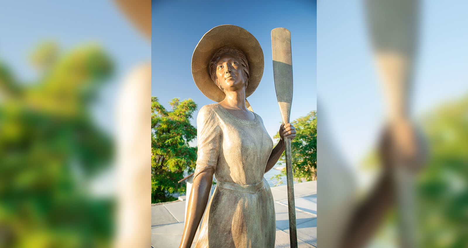 Call of the River young girl with oar sculpture.